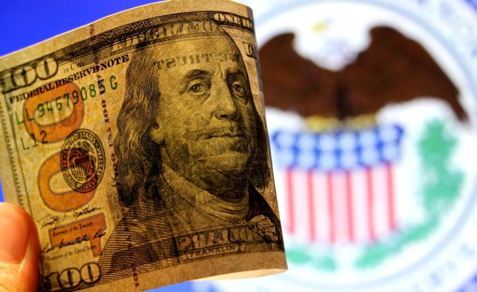 美聯儲祭出鷹派降息,人民幣匯率在岸、離岸一度跌破6.91