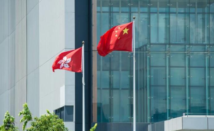 王毅接受法新社專訪談香港問題的兩個基本事實