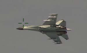 美抗议中国战斗机拦截美侦察机,称相距10米、中方展示武器