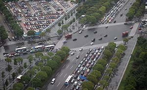 上海2013年新增机动车额度拍卖收入87.9亿元,使用74亿