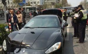 真豪车疑似挂着假临牌,上海警方:一经查实当事人将被行拘