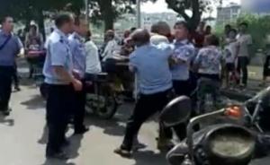 广西玉林城管与两老年摊贩冲突,官方:暴力抗法,已保持克制
