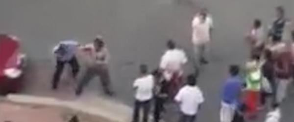 大连夫妻暴力抗法民警鸣枪示警被踢伤下体,双双被刑拘