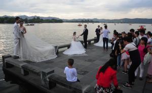 今年国庆京沪市民最热衷旅游,杭州西湖和上海迪士尼人气火爆